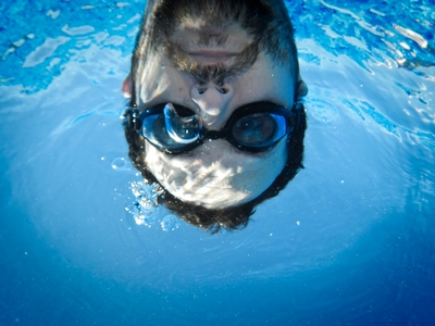 man underwater with goggles