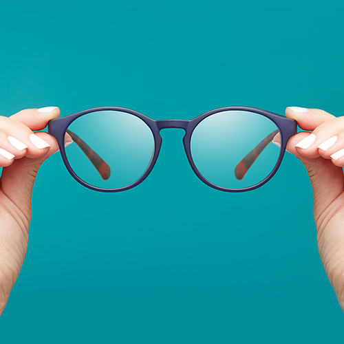 glasses with teal background
