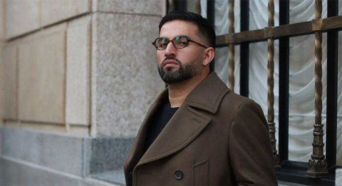 Eff Ulloa with zenni glasses and dark coat